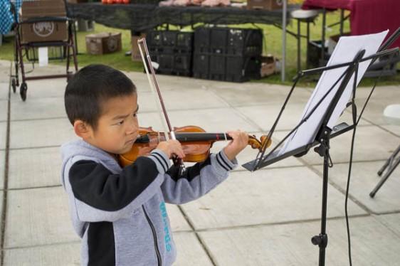 Kevin Zhang, 5, plays violin September 19th.